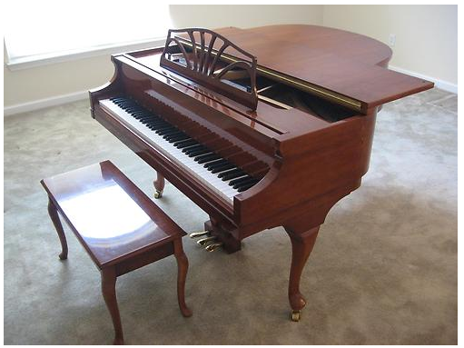 Baldwin petite grand piano cherry wood
